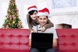 Couple sitting on sofa and buy online