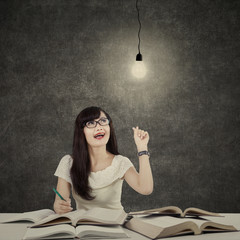 Female student getting bright inspiration 2