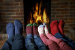 Family Wearing Socks Warming Feet By Fire - 72463270