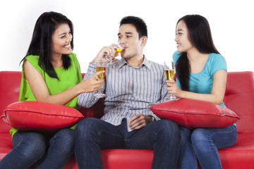 Group of asian teenager drinking champagne