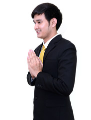 Handsome Thai Businessman with welcome expression Sawasdee, isol