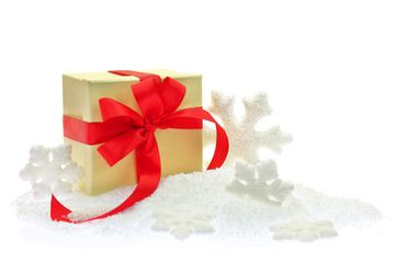 Gift box with red ribbon on snow