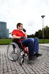 Young man on wheel chair - obstacles in life