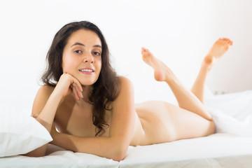 beautiful nude girl lying on bed