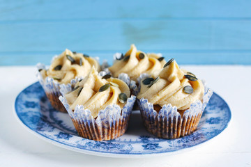 Buttercream pumpkin cupcakes with seeds and icing