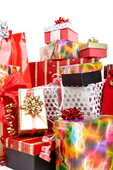 A pile of Christmas gifts in colorful wrapping with ribbons.