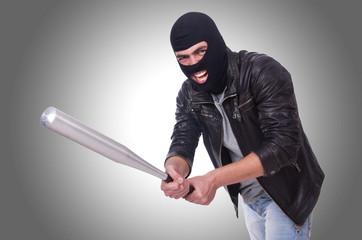 Male hooligan with bat on white