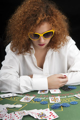 Girl with glasses playing cards