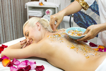 girl on procedure Balinese massage in the beauty salon