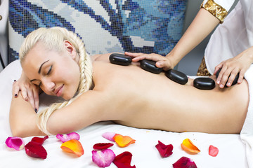 girl on procedure Balinese massage in the beauty salon