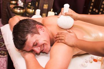 man engaged in Ayurvedic spa treatment