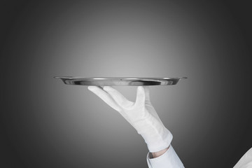 Waiter's Hand Holding Tray Over Gray Background