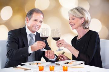 Happy Couple Toasting Wineglasses In Restaurant