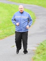 Overweight man running. Weight loss concept.
