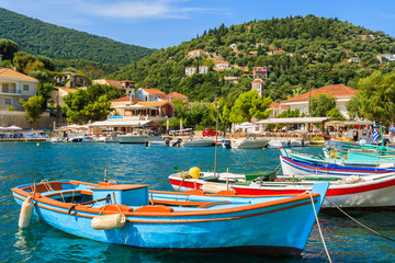 Colorful Greek fishing boats in port of Kioni on Ithaka island
