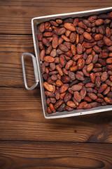 roasted cocoa chocolate beans in Vintage heavy cast aluminum roa