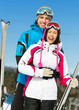 Half-length portrait of two embracing alps skiers