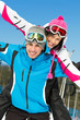 Portrait of happy couple of alps skiers have fun