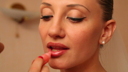 Fiancee paints her lips