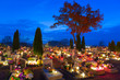 Cemetary at night with colorful candles in All Saints Day - 72471424