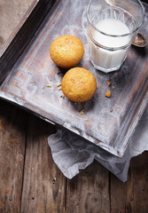 cupcake with glass of milk on old wooden tray