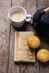 cupcake with cup of coffee with cast iron pot