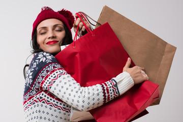 Shopping winter woman embracing shopping bags