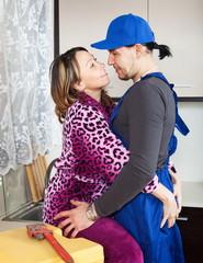 Woman flirting with repairman