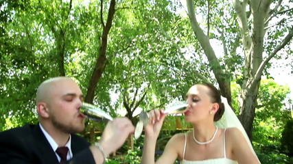 bride and groom drinking champagne 1