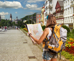 Pretty traveler woman with backpack in a city