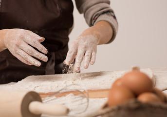 Unrecognizable woman hands cooking dough