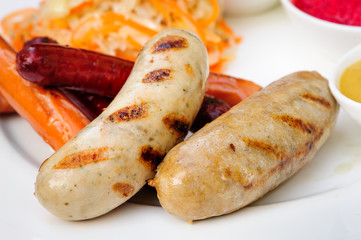 German sausage with cabbage and sauces