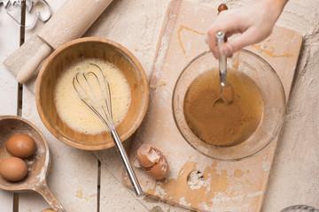 Unrecognizable woman preparing dough