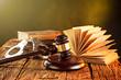 Zdjęcia na płótnie, fototapety, obrazy : Wooden gavel and books on wooden table