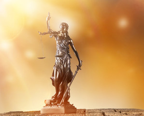 Themis in spotlight, law concept.