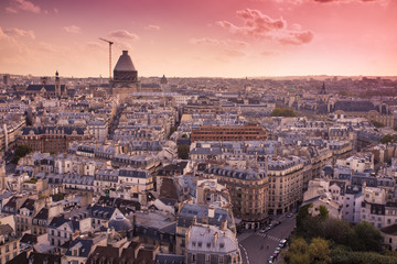 View of Paris France rooftops from above at sunset
