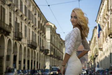 Pretty Young Woman in White Dress at the City