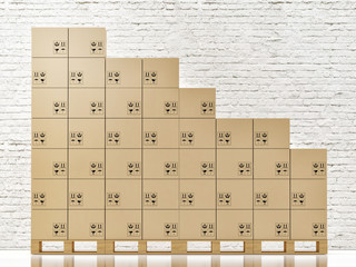 Cardbord boxes on wooden pallete in front of white brick wall