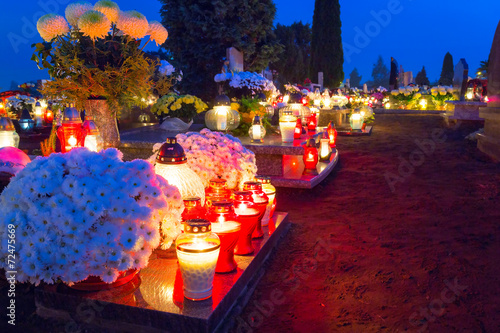 Colorful candles on the cemetery at All Saints Day, Poland - 72475669