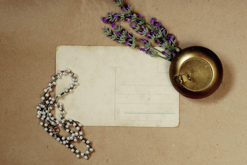 Vintage background with old postcard,  lavender and Jewelry
