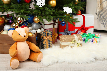Lots of Christmas gifts on floor in festive interior