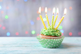 Fototapety Delicious birthday cupcake on table on light background