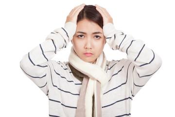 Beautiful Asian girl with scarf got headache