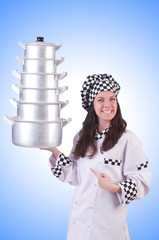 Cook with stack of pots on white