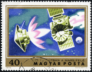 stamp  shows satellite Mariner 4 on course for Mars