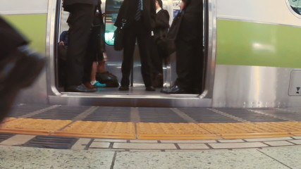 Doors close on business men boarding subway car in slow motion