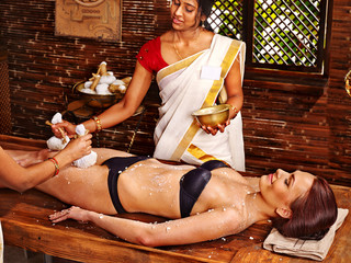 Woman having Ayurvedic feet spa massage.