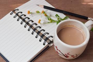 A cup of hot coffee, flowers and book, Romantic background
