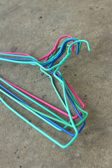 Colorful hangers shirt on a gray background.