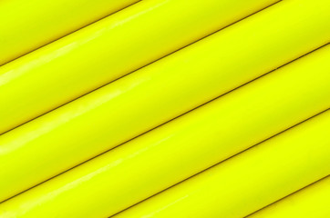 Yellow plastic tubing pattern texture background